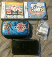 Nintendo DS Lite black w 5 games, bakugan carry case, stylus, and charger