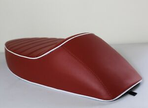 VESPA SEAT SPORTS SEAT  STYLE - RALLY, SPRINT ,SUPER ETC IN RED W WHITE PIPING