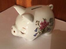A medium ceramic piggy bank with detailed floral decoration