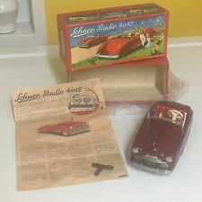 SCHUCO VINTAGE TIN DUAL CLOCKWORK RADIO CAR 4012 IN RED. WORKING W/ORIGINAL BOX!
