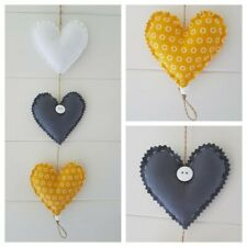 Handmade fabric Hanging Hearts 3 in Grey/white and mustard (yellow).