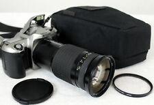 Nikon F65 camera, with Tokina AF 28-210mm 1:3.5 to 5.6 with carry bag..