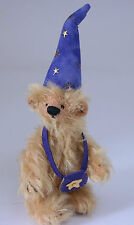 Deb Canham Light brown miniature mohair bear with purple hat and bag of spells