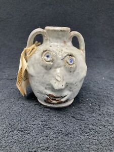 Bolick pottery two sided mini face jug with chip