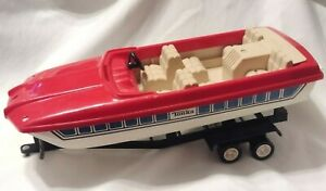 Vintage red plastic Toy Tonka Boat and Trailer (missing windshield)