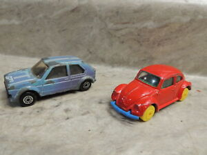Pair of Maisto VW's Blue GTI & Red 1300 w/ Yellow Wheels (Rare Colors)