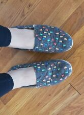 Well-worn women's Size 8 TOMS Sherpa Lined Flats