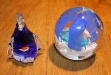 Two Glass paperweights penguin and palm tree