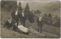 1920s Young Men Rest on European Hillside in Valley Real Photo Postcard