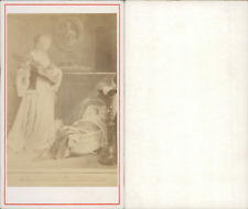 Une mère jouant de la musique pour son enfant, d'après un dessin  Vintage C