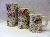 Heron Cross Pottery set of 3 jugs in British birds design.