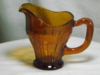 Vintage footed Dark Amber glass milk / cream jug. Art deco?