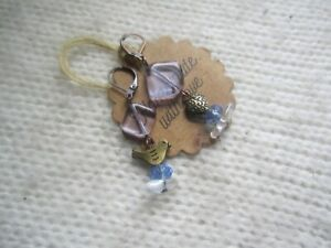 copper/brass asymmetrical bird/heart earrings with glass blue beads I