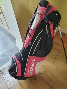 titleist stand bag, damaged top, otherwise perfect . Sold as seen. No strap