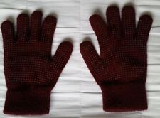 A pair of child size burgundy riding gloves