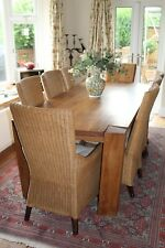 Solid Ypsilon oak dining table and 8 Colonial dining wicker chairs