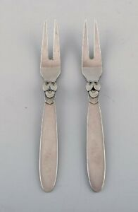 Two Georg Jensen Cactus cold meat forks in sterling silver.