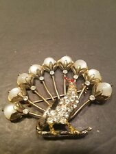 Antique  Glass /Rhinestones Peacock brooch. Gold tone finish.
