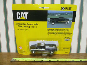 Caterpillar Dealership Black GMC Dually Pickup By Norscot 1/64th Scale >