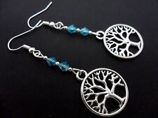 A PAIR OF  TIBETAN SILVER TREE OF LIFE THEMED BLUE CRYSTAL EARRINGS. NEW.