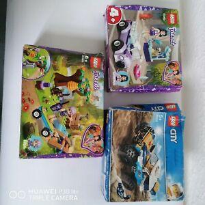 3 Lego toys, damaged boxes, unopened.