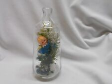 vintage glass canister decorated for Christmas w angel & decorations