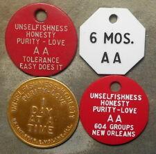4 New Orelans LA area AA tokens. Plastic & anodized aluminum, largest is 32mm,