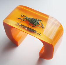 Large bright yellow lucite cuff bracelet with real beetle