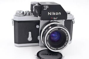 Chrome Nikon F, red dot camera, fitted with a black Photomic (FTN ?) prism, 50 F