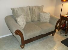 Love seat with 2 extra pillows in great condition non smoking home.Wood trim.
