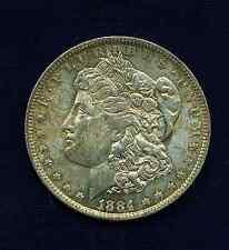 U.S.  1884-O  MORGAN SILVER DOLLAR UNCIRCULATED! LIGHT GOLD TONING!!