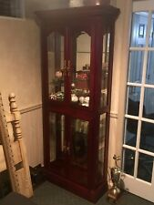 Curio Cabinet w mirrors. Two sections, 4 glass shelves. Excellent condition.