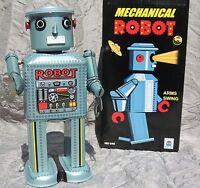 Robot mécanique en tole. MECHANICAL ROBOT gris argenté hauteur 22 cm. MS646