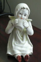 """Vintage Germany Early Bisque Sitting Girl in Bonnet w Cup Figurine 3 1/2"""" Tall"""