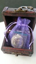 Treasure Chest With A Bag Of Three US Coins - One Dollar, Fifty cent and Quarter