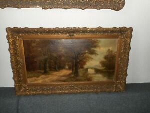 Large antique oil painting, Woodslandscape with a river, is signed, great frame!