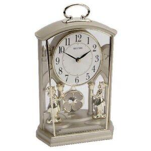 rhythem mantel clock no 4RP796WR18 with pendulum movement 23cm tall