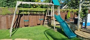 wooden climbing frame with monkey bars