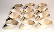 SET OF 12 LEONARD SILVER PLATE NAPKIN RINGS IN CONTEMPORARY SLANTED OVAL SHAPE