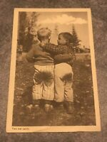 rppc postcard Two Wet Pants Cute Little Boys In Field 1949