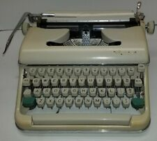 VINTAGE OLYMPIA TYPEWRITER with original case nice condition. tested