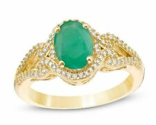 Zales Oval Emerald and 1/5 CT.T.W. Diamond Frame Scrolling Split Shank Gold Ring