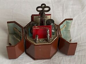 A early 19th century lacquered wood octagonal etui. The top opens to reveal a sc