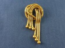 Broche Art Déco en maille serpent dorée