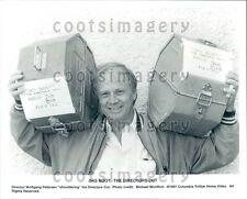 1997 Movie Director Wolfgang Petersen Holding Cans of Das Boot Press Photo