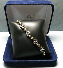 Bracelet en or jaune 18K et acier