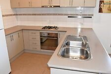 Kitchen cupboards, benchtop and appliances, complete