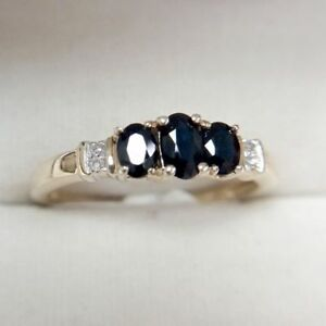 9ct Yellow Gold Ring with Oval Cut Blue Sapphires and Diamonds