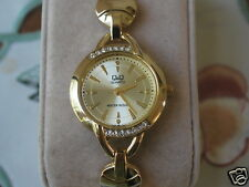 New Q&Q by Citizen Gold Tone Lady Dress Watch w/Diamond Bezel