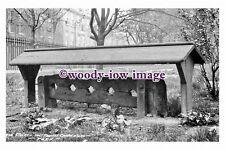 pu0335 - Stocks in Holy Trinity Church Yard , York , Yorkshire - photograph